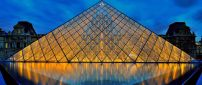 Louvre museum pyramid lighted in night