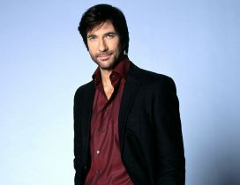 Dylan McDermott in black and red