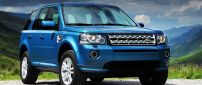 Blue Land Rover Freelander in mountains
