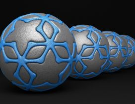 3D gray balls with blue lines on black background