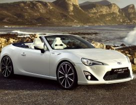 White Toyota FT-86 on the shore of sea