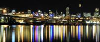 Colorful lights reflected in water in night - Sydney Anzac