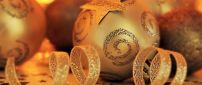Golden Christmas bals and ribbon for presents
