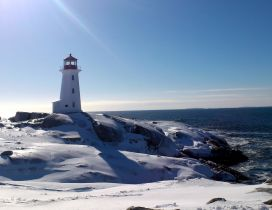 Winter time on the sea - lighthouse in the sun