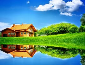 Wonderful house mirror in the lake - Sunny summer day