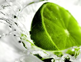 Green lime in the water - delicious fresh drink