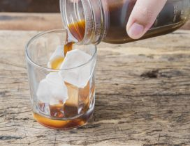 Coffee with ice cubes - fresh drink in the morning