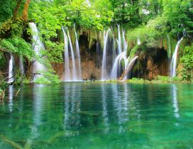 Green nature - beautiful waterfall and mountain lake