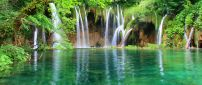 Green nature - beautiful waterfall and mountain lake