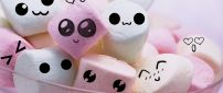 Cute and funny faces on marshmallows