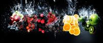 Fresh fruits under the cold water - HD summer time