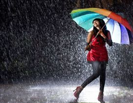 Happiness - Dance in the rain with a big colorful umbrella