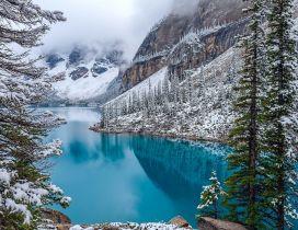 Wonderful blue mountain lake in the winter season