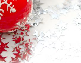 Silver stars and one red Christmas ball