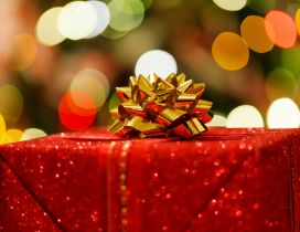 Wonderful golden ribbon on a red Christmas gift