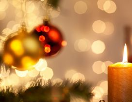 Golden candle under the Christmas tree - Magic light