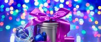 Purple ribbon on a Christmas gift - Lights on background