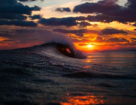 Big waves in the cold ocean water - Wonderful sunset