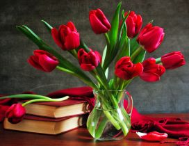 Red books and wonderful bouquet of red tulips - Flowers