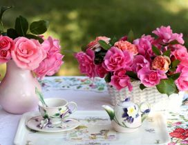 Special tea in a wonderful garden full with pink roses