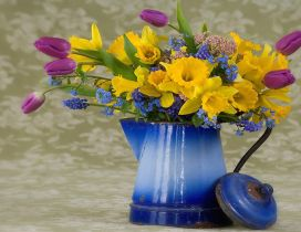 Old vase with wonderful spring flowers