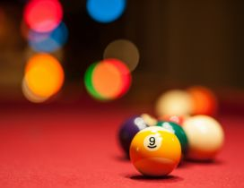 Yellow pool ball - Number nine on the table