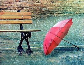 Red umbrella near a bench - Rainy day