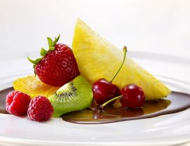 Delicious plate full with chocolate and fruits - Color