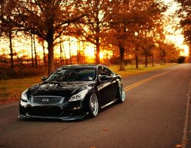 Beautiful Infinity black car on the road - Autumn season