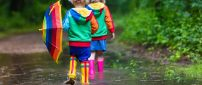 Colorful Autumn clothes for happy children -Play in the rain