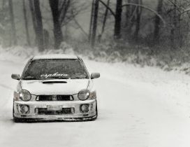 White race car on the road in the winter season