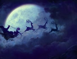 Santa Claus flying on the sky with the deers -Christmas time