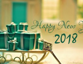 Green boxes with presents for a new beginning - Happy 2018