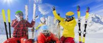 Happy people at skiing in the mountain - Colorful clothes