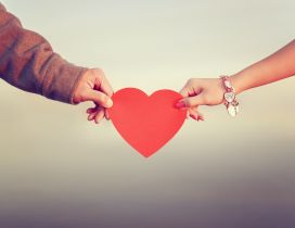 Love between two people - Red Heart give on Valentines Day