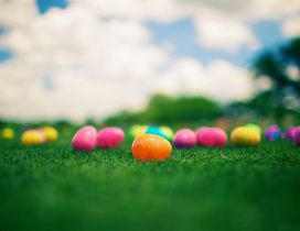 Plastic Easter eggs on the grass - Happy Spring Holiday