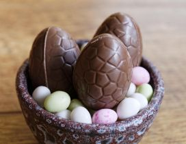 Chocolate Easter eggs in a basket - Happy Spring Holiday