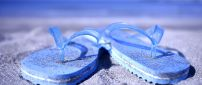 Macro blue flip flop full with beach sand - Summer time