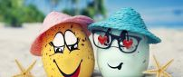 Two funny eggs on the beach - Love moments
