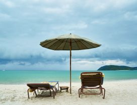 Summer chairs on the beach - Happy holiday