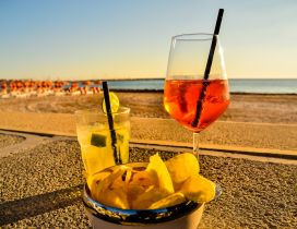 Summer fruits and cocktails on the beach