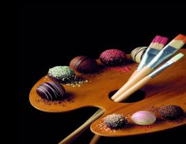 Candies palette with chocolate for painting - Original photo
