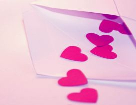 Pink paper hearts in an envelope - HD Valentine's Day