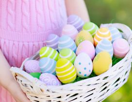 Girl with a basket full with Easter eggs - Happy Holiday