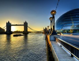 London Bridge and the Sun rise up - modern building in right