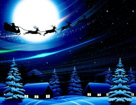 Santa Claus is in the air with reindeers - Christmas night