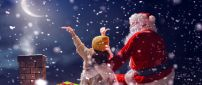 Magic time with Santa Claus on the roof - Christmas holiday