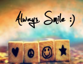 Always smile - Funny symbols on small wooden cubes